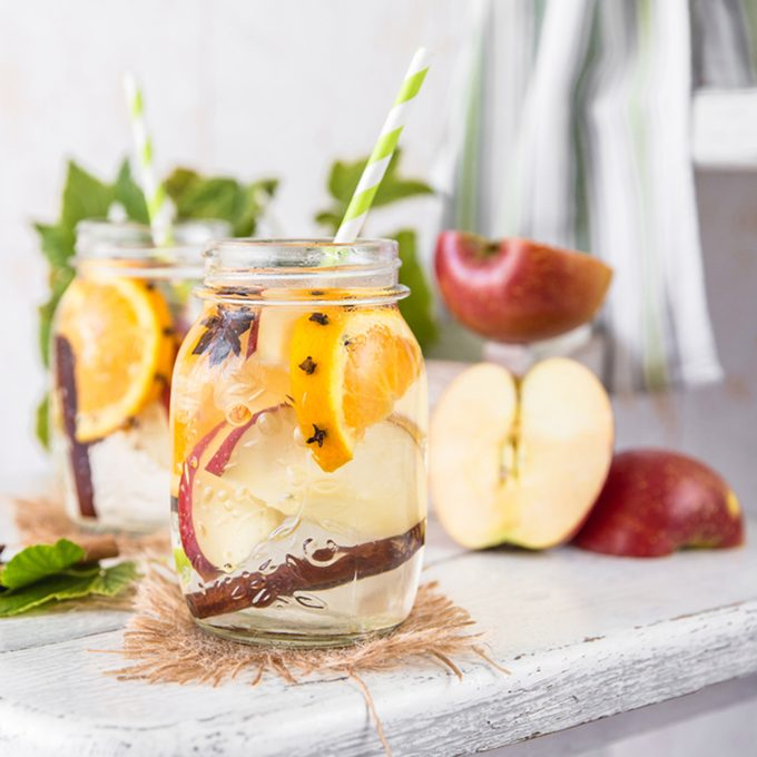 Cold Fruit Christmas Infused Detox Water with apple, orange, cinnamon and clove spice