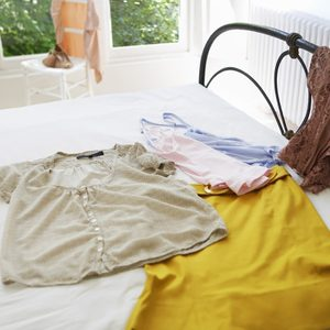 Female outfit laid out on bed; Shutterstock ID 50754187