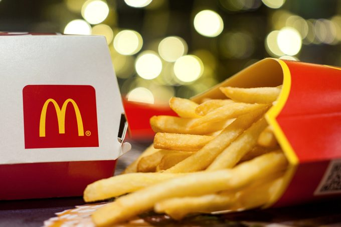 Minsk, Belarus, January 3, 2018: Big Mac Box with McDonald's logo and French fries in McDonald's Restaurant