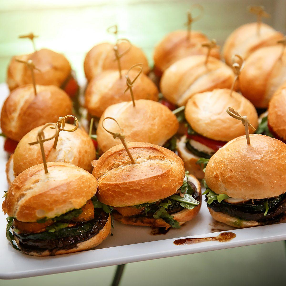mini burger canape selection on slate platter