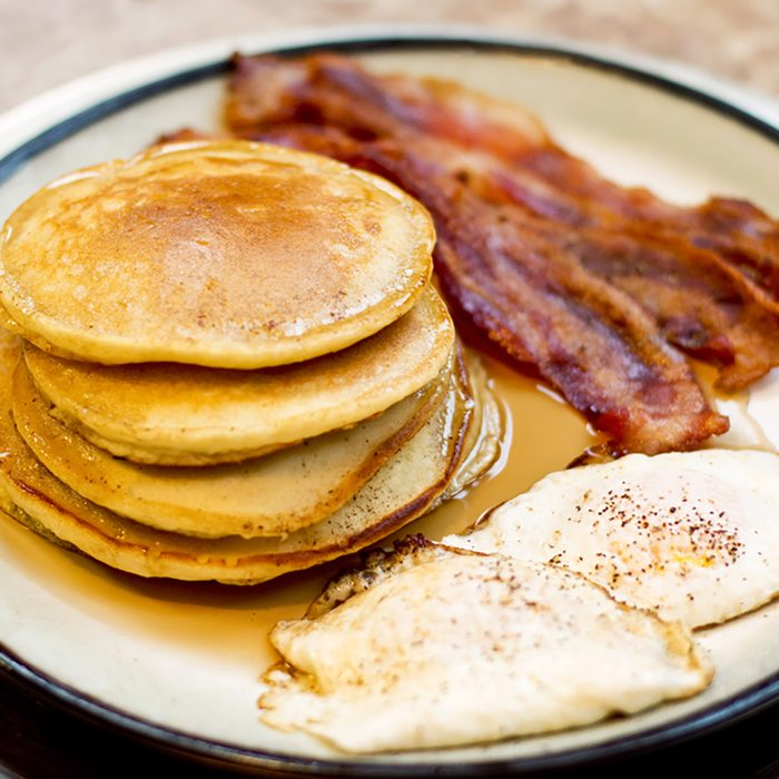 Pancake Bacon and Egg Breakfast on a Large Gold Plate