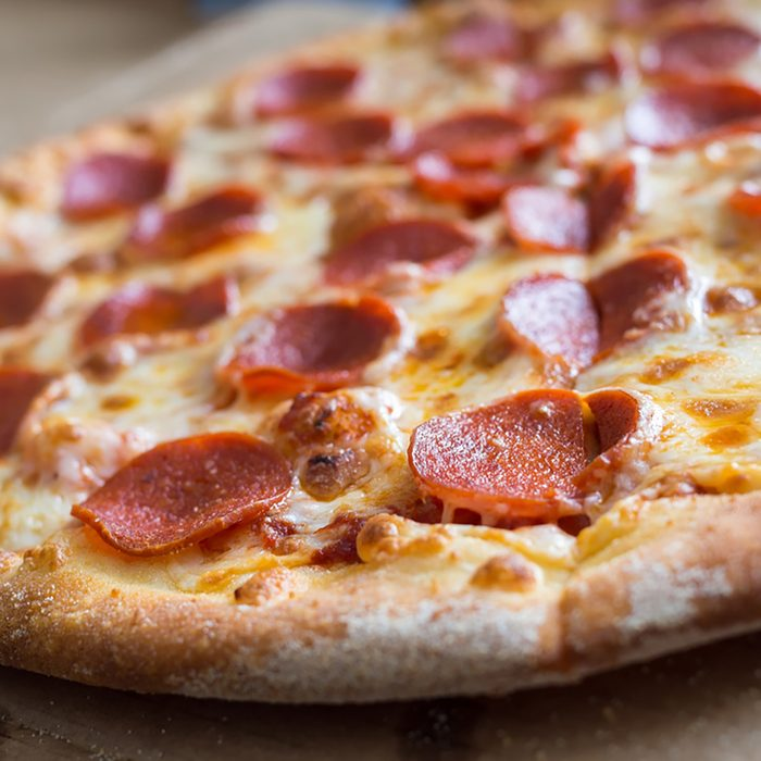 Fresh baked pepperoni pizza, shallow depth of field; Shutterstock ID 522293875