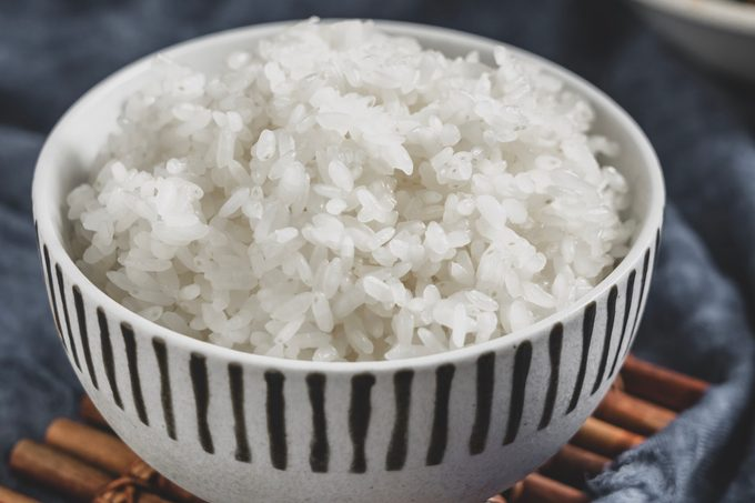 A bowl of cooked jasmine rice.