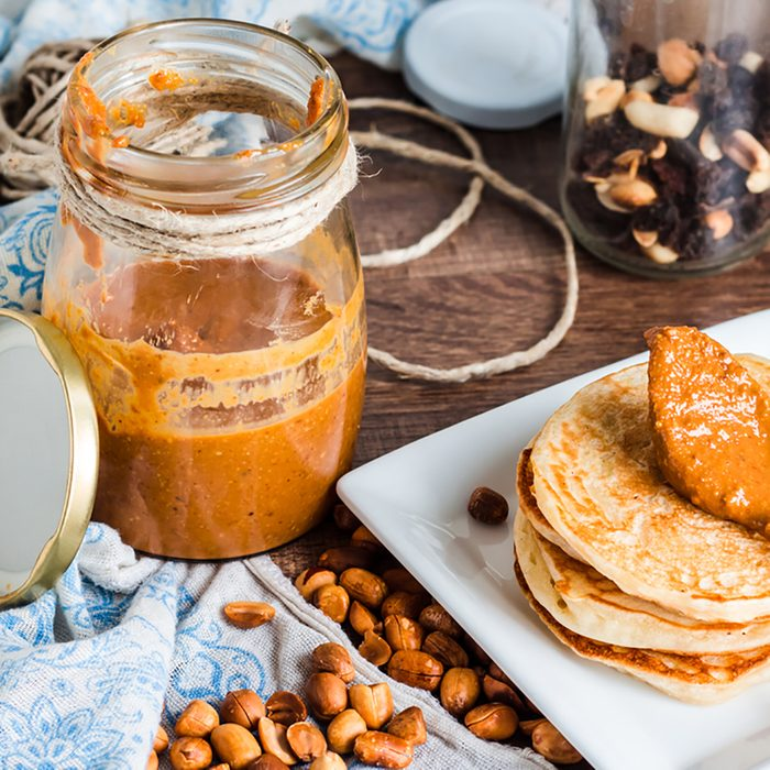 peanut butter in a jar, eat a teaspoon, fresh peanuts and pancakes; Shutterstock ID 252419200; Job (TFH, TOH, RD, BNB, CWM, CM): Taste of Home
