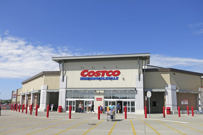 Costco Wholesale storefront in Hamilton Ontario, Canada. Costco operates a chain of membership warehouses, carrying merchandise at lower prices.