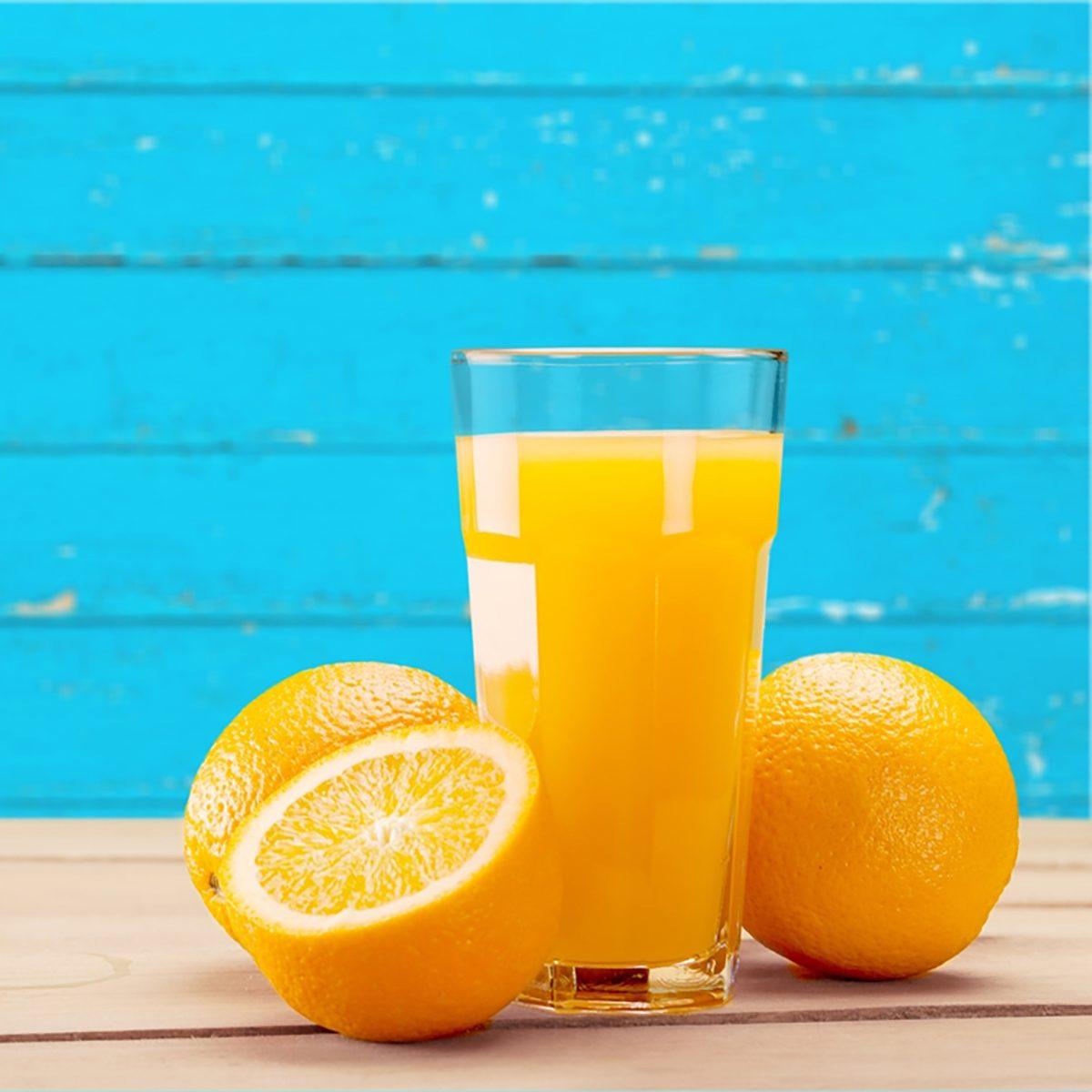 Orange Juice on blue background.