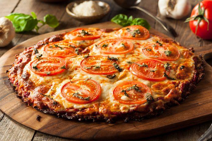 Homemade Vegan Cauliflower Crust Pizza with Tomato and Basil; Shutterstock ID 409592167