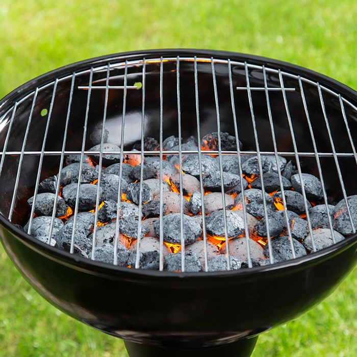 Empty grill with red-hot briquettes, close-up