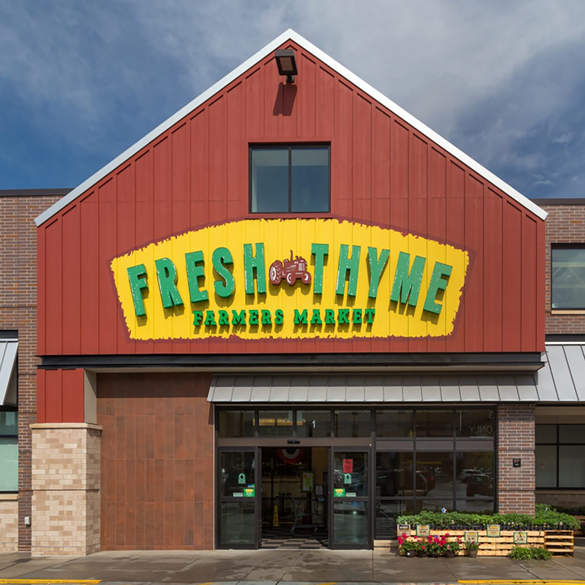 Fresh Thyme Farmers Market exterior and logo. Fresh Thyme is a chain of grocery stores in the United States.