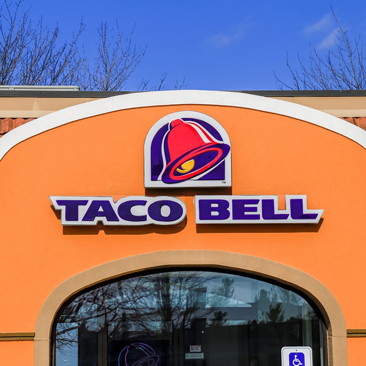 Exterior of Taco Bell fast-food restaurant with sign and logo.
