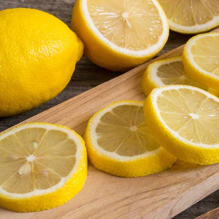 Lemon slices on the old wooden table.
