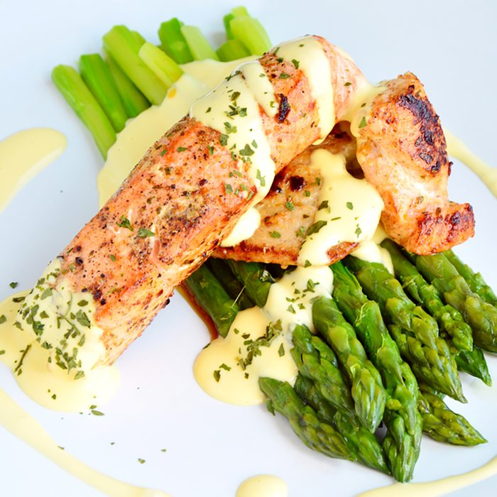 Green Asparagus with salmon and hollandaise sauce (German name is Spargel mit Lachs und Sauce Hollandaise) Menu for spring season