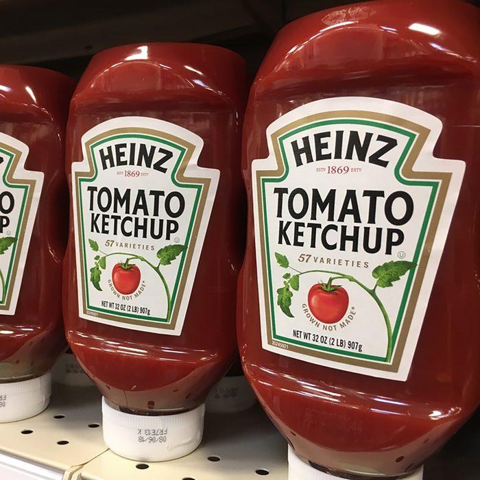 PHOENIX, ARIZONA, AUGUST 6, 2017: Heinz Ketchup Bottles on Shelf; Shutterstock ID 691739383