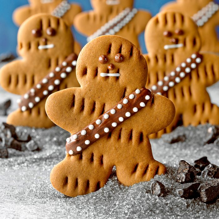 Wookiee Cookies; Low camera angle; cutout cookies; shaped cookies; star wars; May the 4thbe with you; gray surface; Blue background; rock candy; snack; dessert; cookies; gingerbread; gingerbread man; chocolate chips
