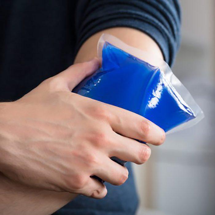 man applying ice pack