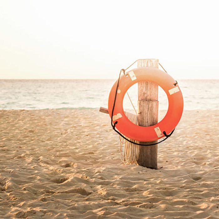 Life preserver on sandy beach somewhere in Mexico