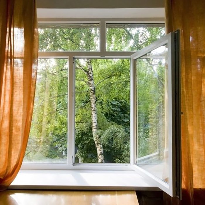 open windows with curtains