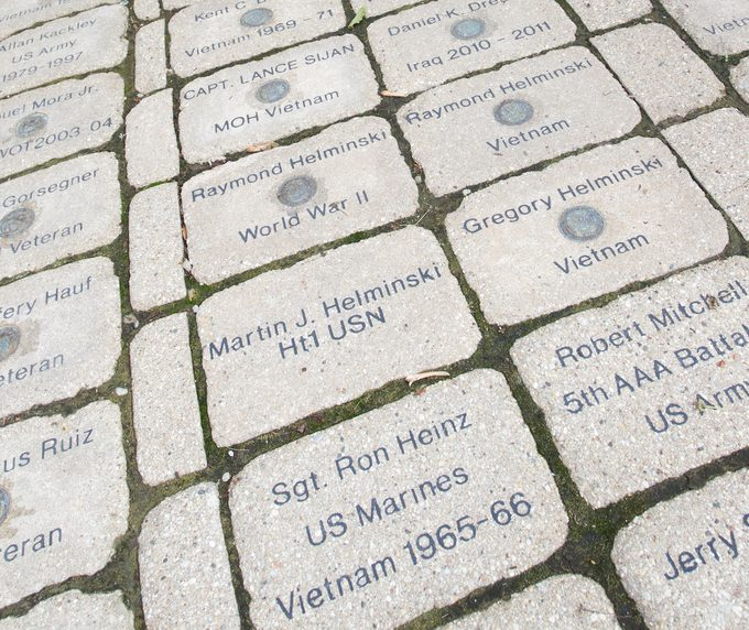 Bricks Leading to Dryhootch Coffee Shop with the names of veterans