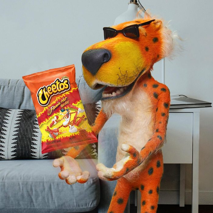 chester cheetah with flaming hot cheetos