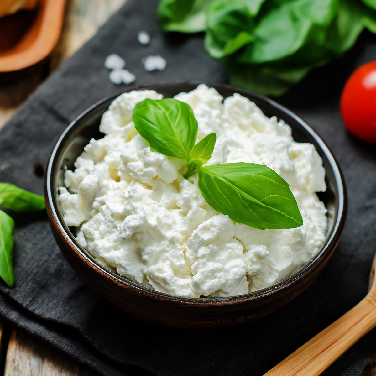 ricotta cheese on a wood background. the toning. selective focus
