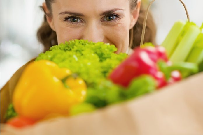 Woman with bag of fresh produce
