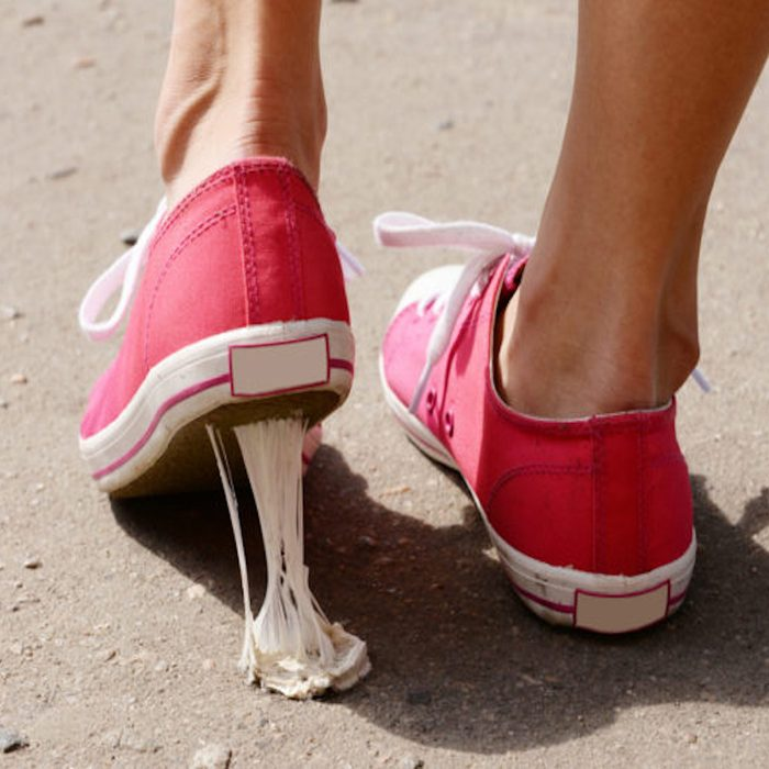 Foot stuck into chewing gum on street; Shutterstock ID 207965554; Job (TFH, TOH, RD, BNB, CWM, CM): TOH how to remove gum