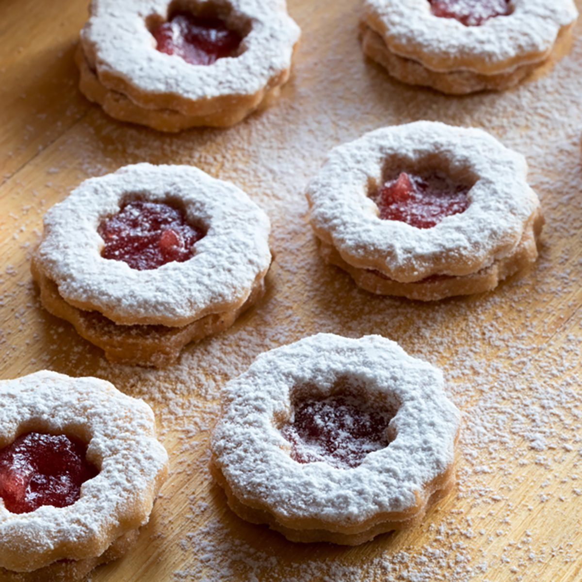 Trraditional Linzer Christmas cookies filled with marmalade and dusted with sugar