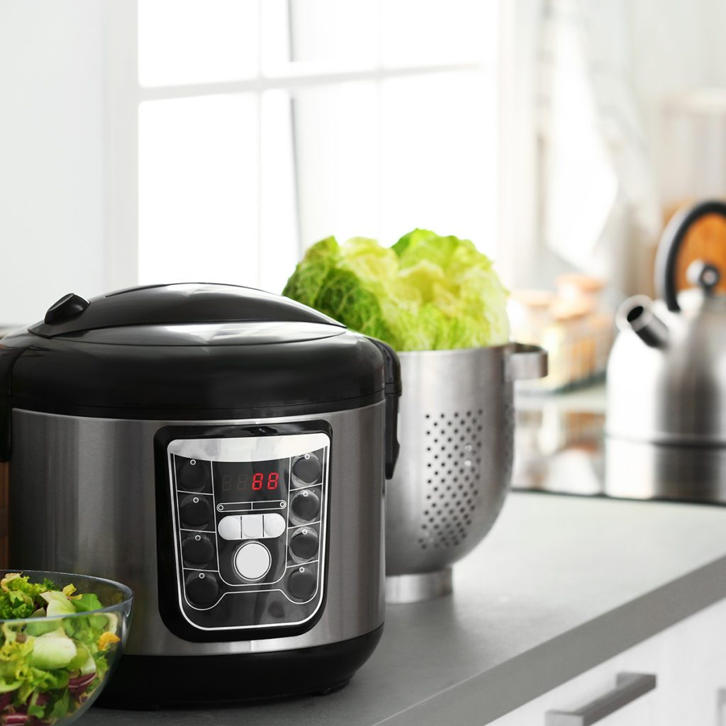 Modern electric multi cooker and food on kitchen countertop. Space for text; Shutterstock ID 1304469877; Job (TFH, TOH, RD, BNB, CWM, CM): Taste of Home