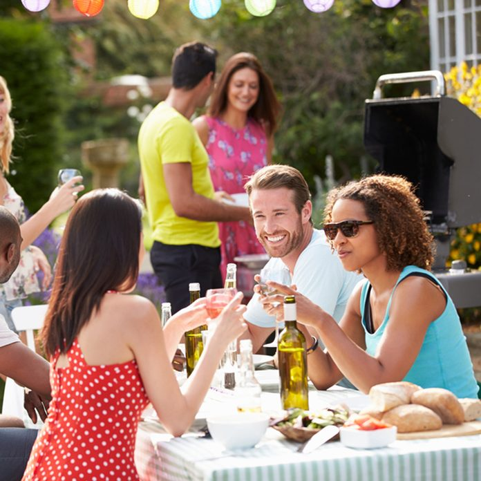 Group Of Friends Having Outdoor Barbeque At Home; Shutterstock ID 165811274; Job (TFH, TOH, RD, BNB, CWM, CM): Taste of Home