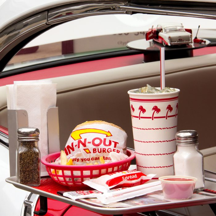 Depiction In-N-Out Burger drive-in restaurant at Pasadena Police Classic Car Show.