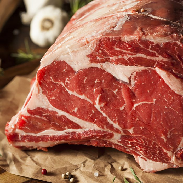 Raw Grass Fed Prime Rib Meat with Herbs and Spices
