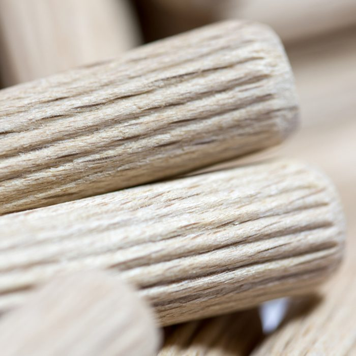 Close macro view of wooden dowels.