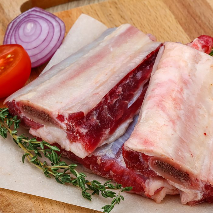 Raw beef ribs with rosemary and thyme - ready for cooking