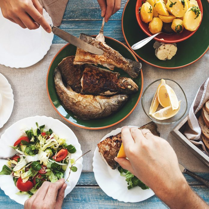 Family dinner with fried fish, potato and salad; Shutterstock ID 359270072