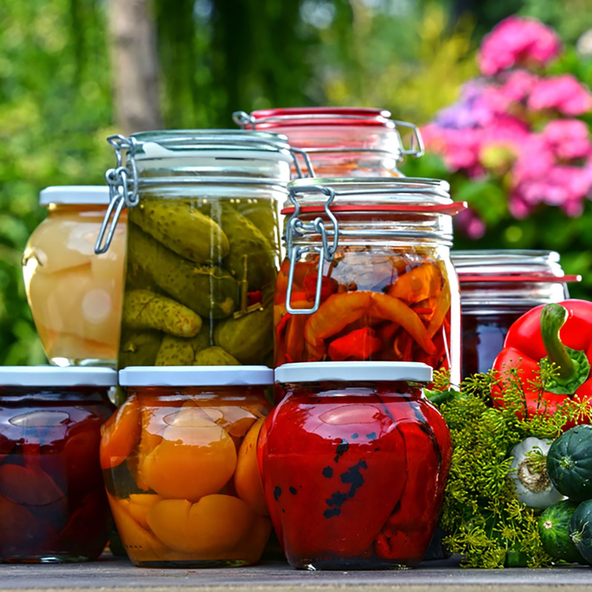Jars of pickled vegetables and fruits in the garden.