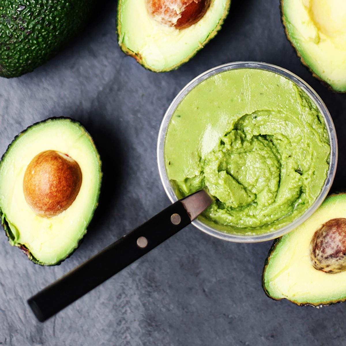 Guacamole. Avocado on a black background,