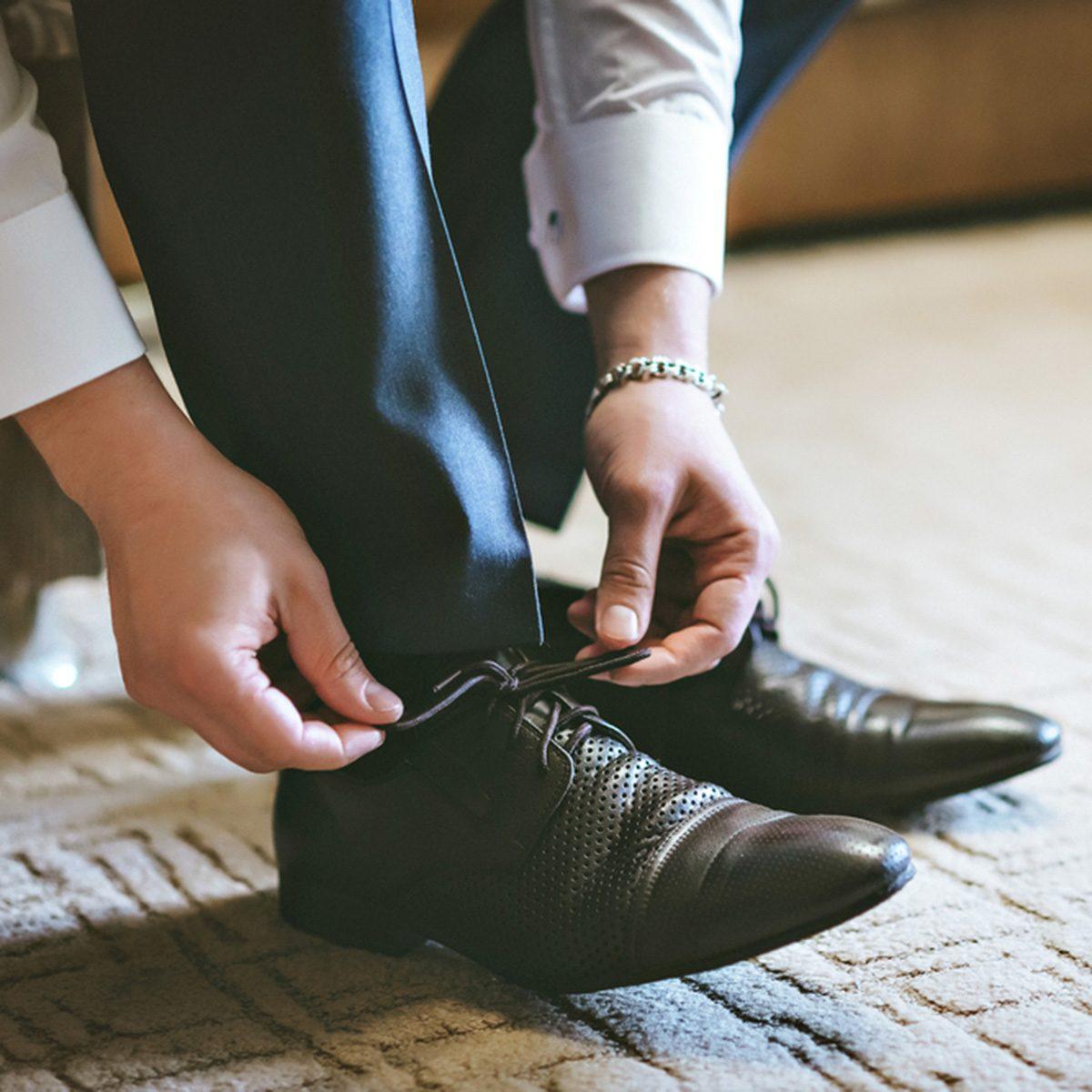Men wearing work black boot. returning to the house.; Shutterstock ID 402941773; Job (TFH, TOH, RD, BNB, CWM, CM): Taste of Home