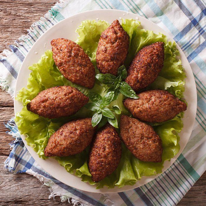 Arabic cuisine: meat appetizer kibbeh close-up on a plate.