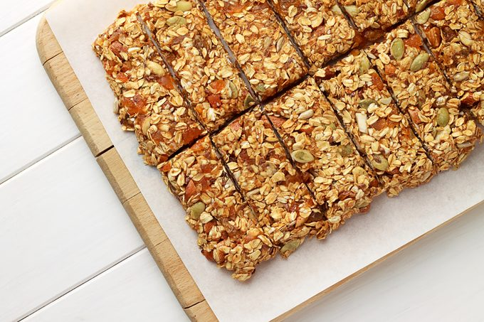 No baking granola bars on white wooden table. Healthy food for diet.; Shutterstock ID 591223463