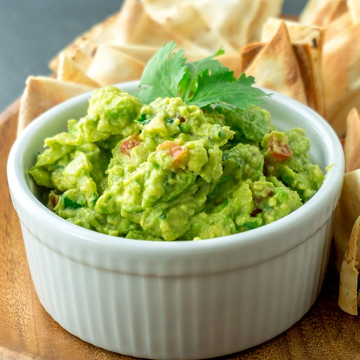 Fresh guacamole bowl. Guacamole is a avocado based dip, traditionally a mexican (Aztecs) dish. Healthy and easy to make at home with a few simple ingredients.