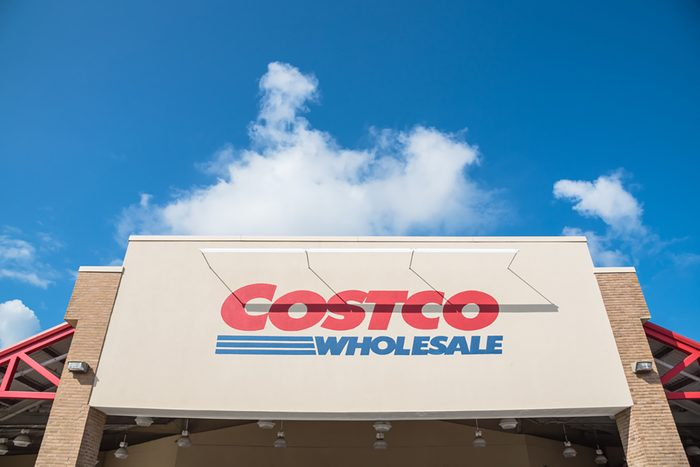 Close-up facade and logo of Costco storefront. Costco Wholesale Corporation is largest membership-only warehouse club in US.