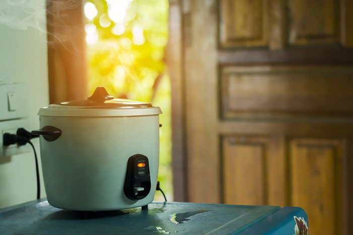rice cooker in the kitchen, steam from the rice cooker