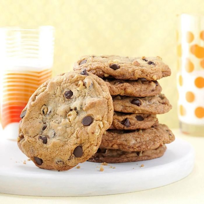 A stack of chocolate chip cookies on a plate.
