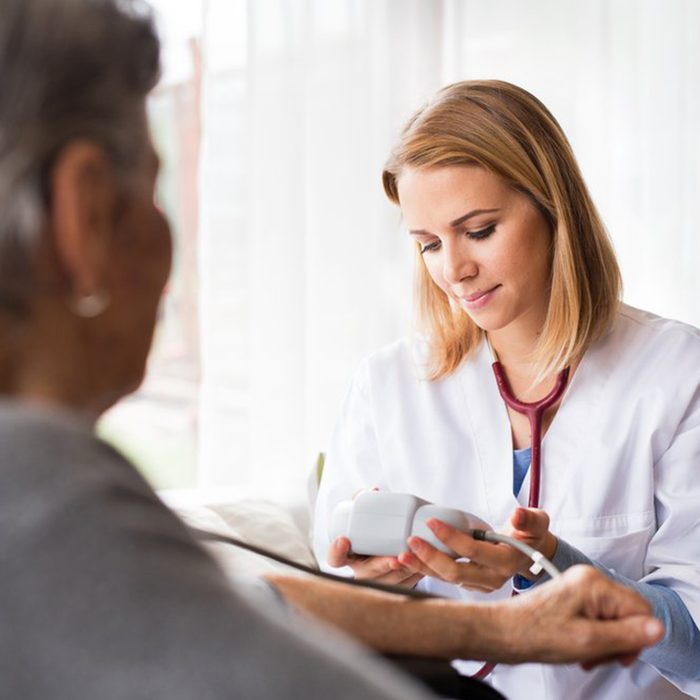 Doctor checking her patient's numbers