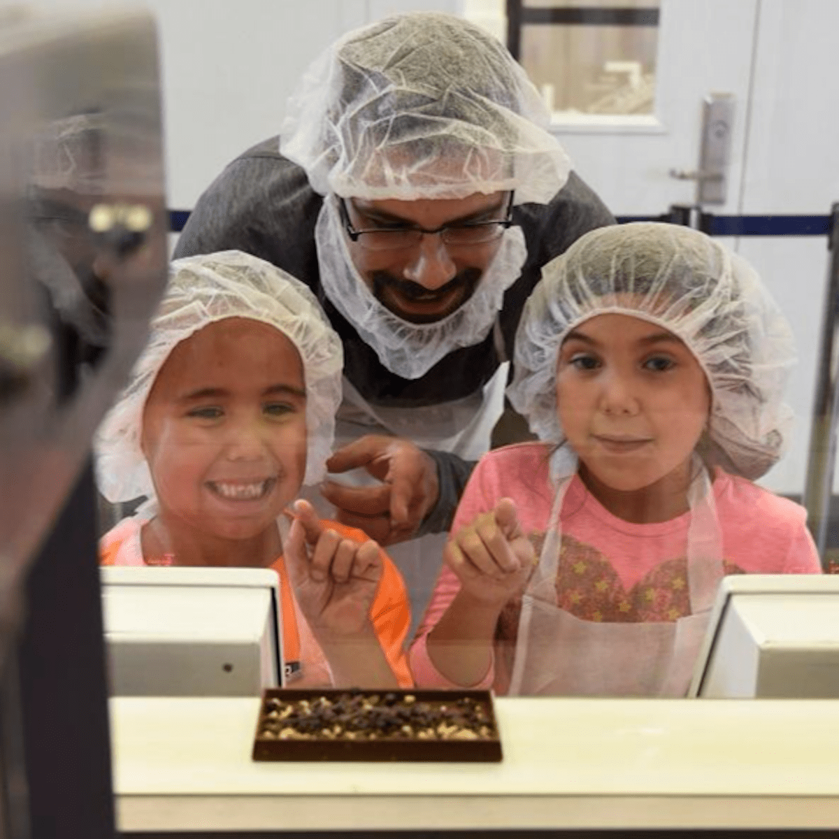Children looking at chocolate at Hershey's World