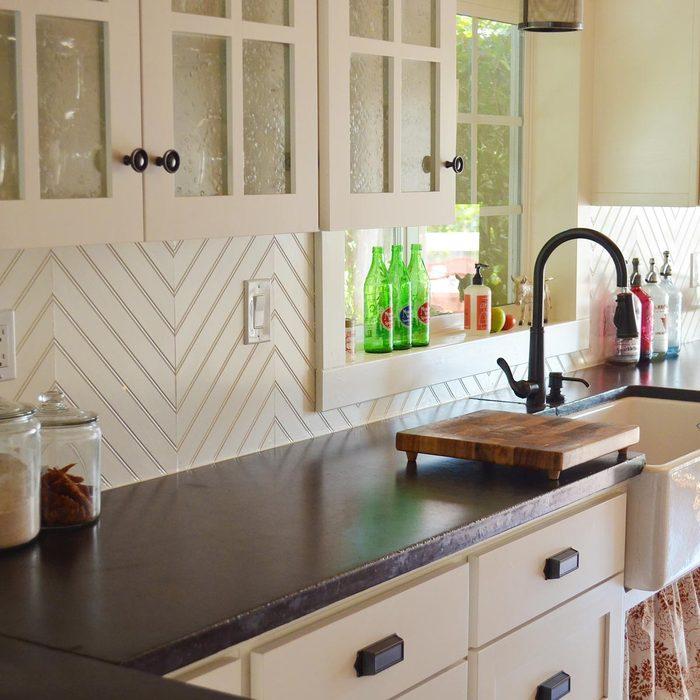 Kitchen with patterned wood backsplash