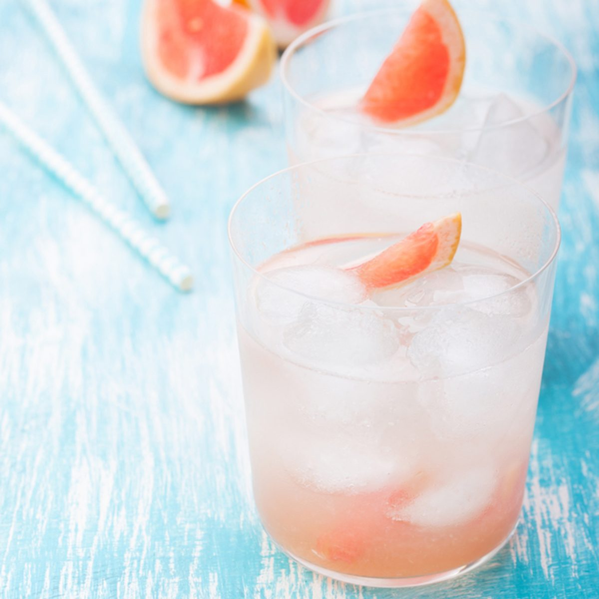 Juicy grapefruit cocktail with ice and alcohol