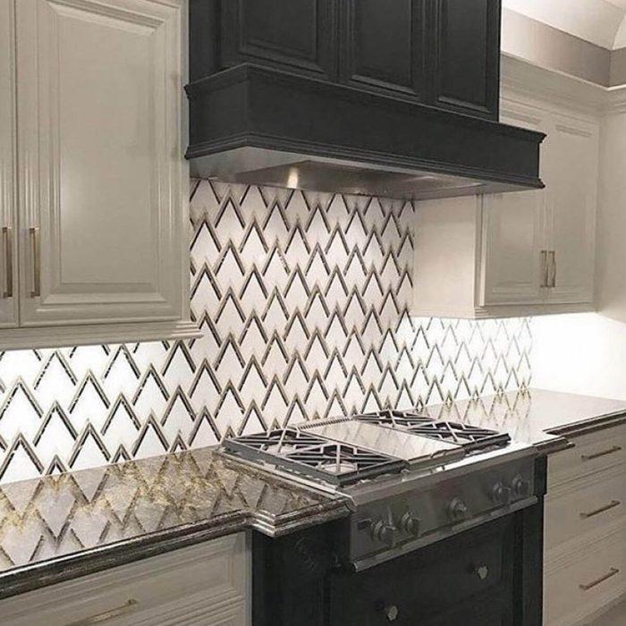 Kitchen with an art deco-style backsplash