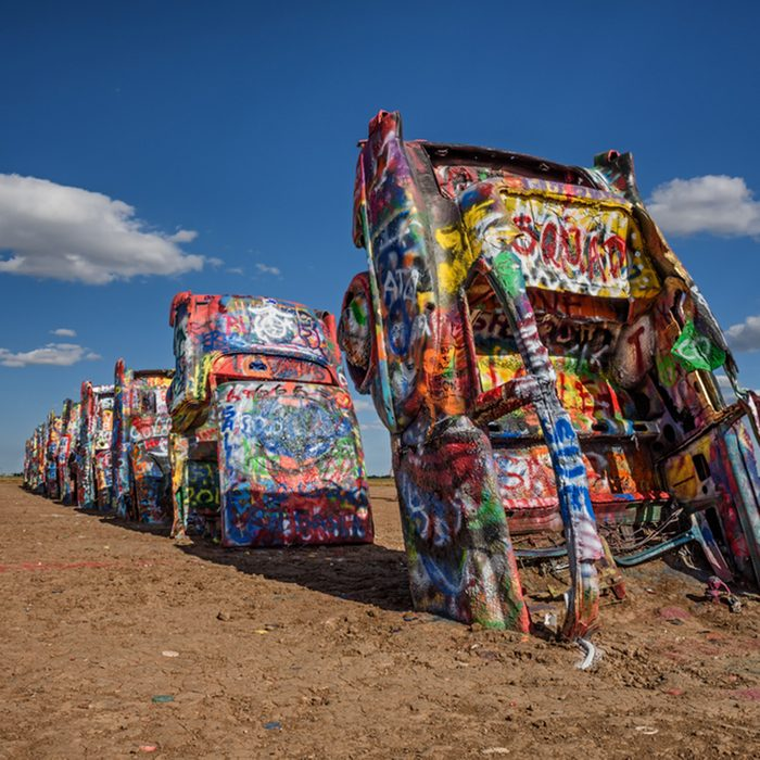 AMARILLO, TEXAS, USA - MAY 12, 2016 : Cadillac Ranch in Amarillo. Cadillac Ranch is a public art installation of old car wrecks and a popular landmark on historic Route 66; Shutterstock ID 477078388; Job (TFH, TOH, RD, BNB, CWM, CM): TOH