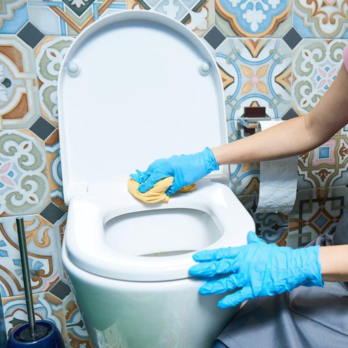 woman clean toilet